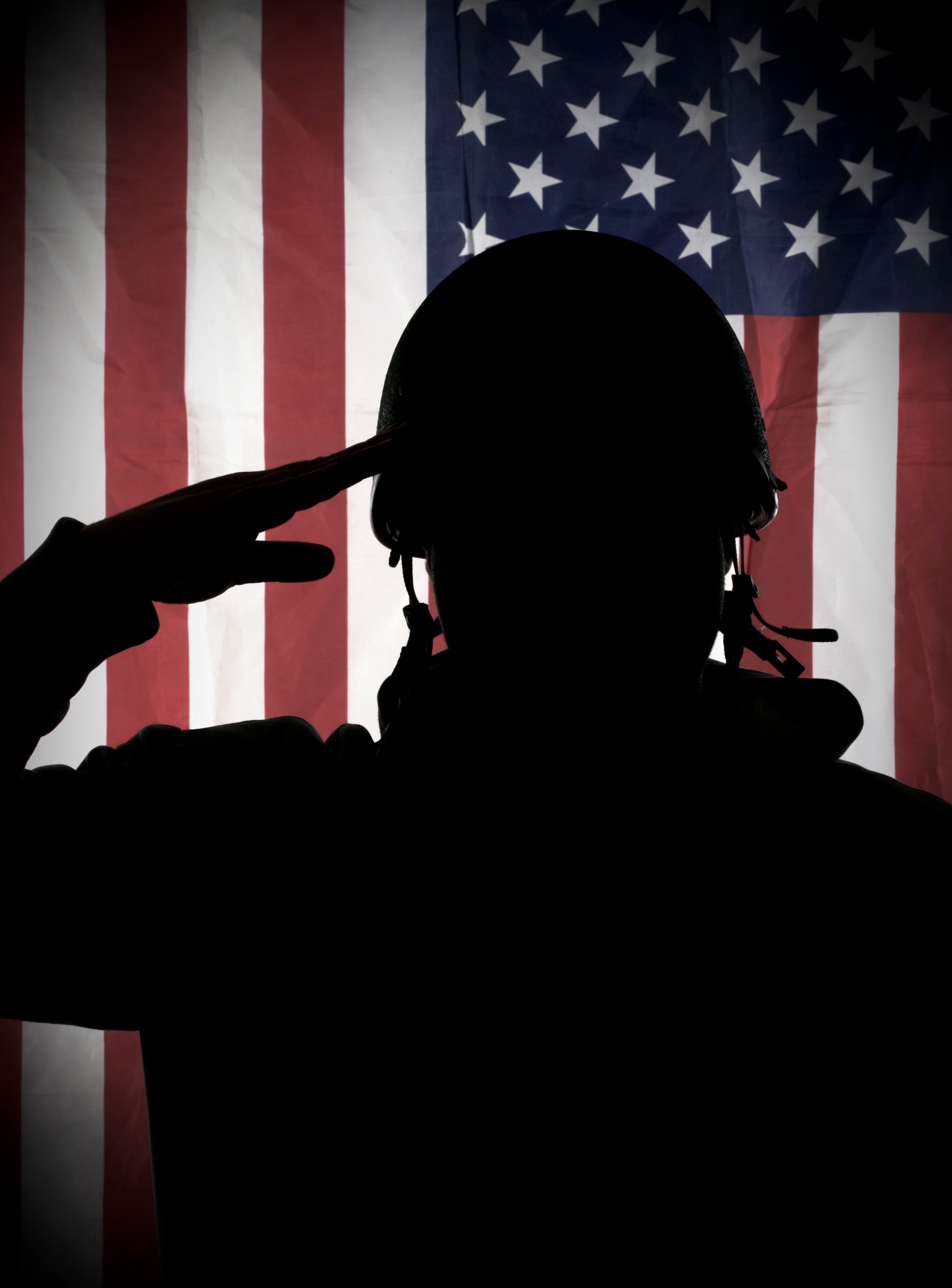 Soldier saluting at the American flag