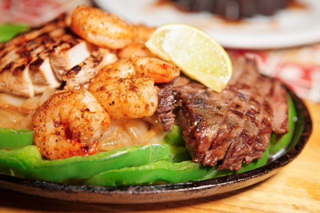 Fajitas with shrimp, chicken, and beef