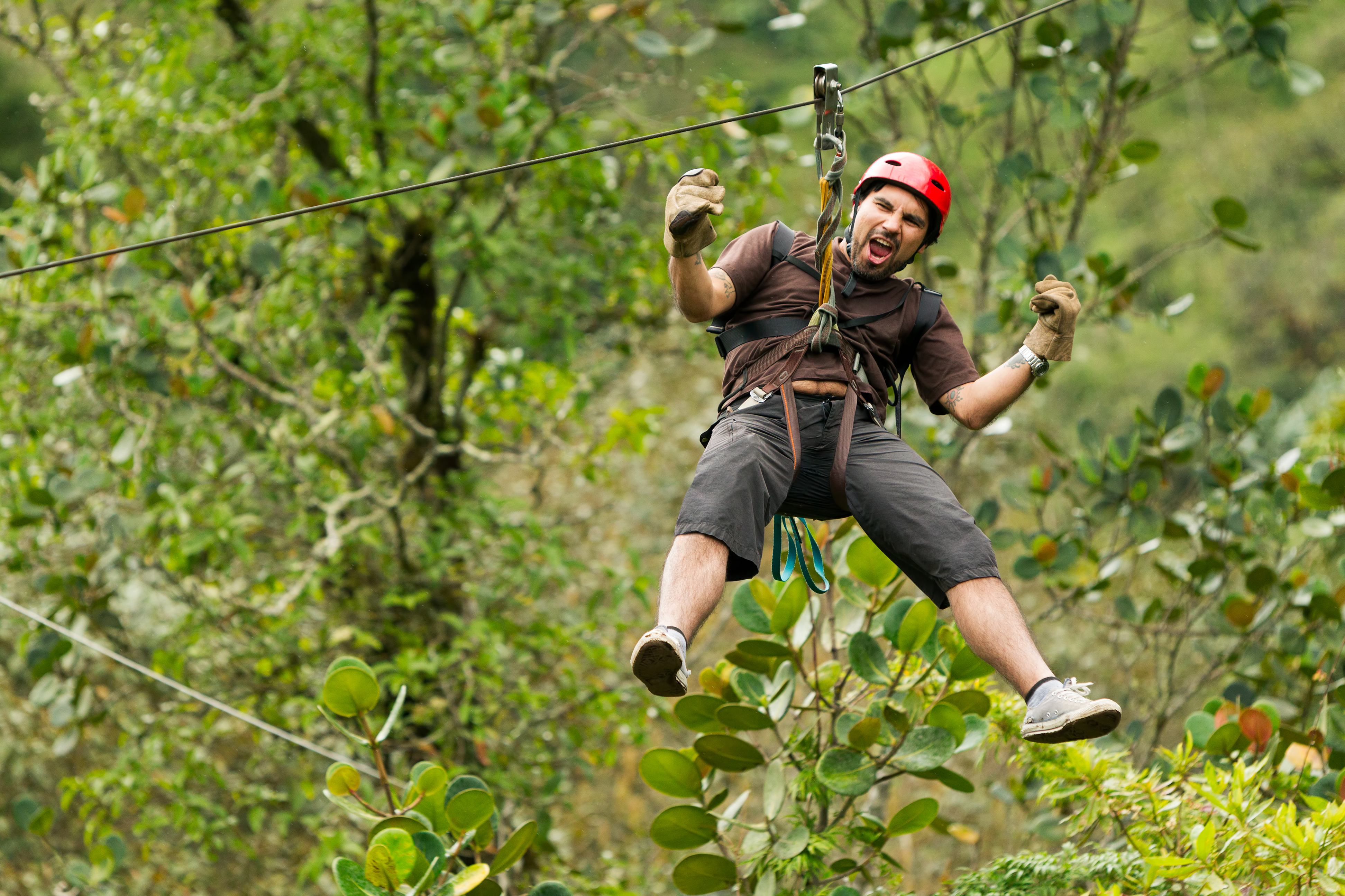 Excited man zip lining